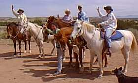 Gals enjoying experienced horseback rides at Makarios Ranch, Santa Fe county New Mexico.  Scenic Galisteo Basin.