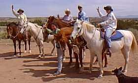Gals enjoying experienced horseback rides at Makarios Ranch, Santa Fe county New Mexico.  Scenic Galisteo Basin.
